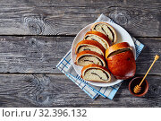 Купить «sweet dough roulade with poppy seeds filling», фото № 32396132, снято 30 августа 2019 г. (c) Oksana Zh / Фотобанк Лори