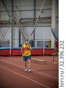 Купить «Pole vaulting indoors - a man standing on the track with a pole», фото № 32396232, снято 1 ноября 2019 г. (c) Константин Шишкин / Фотобанк Лори