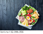 Купить «toasts, cheddar cheese, apple, scotch eggs, greens», фото № 32396356, снято 5 сентября 2019 г. (c) Oksana Zh / Фотобанк Лори