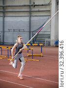 Купить «Pole vaulting - pretty woman is running with long pole», фото № 32396416, снято 1 ноября 2019 г. (c) Константин Шишкин / Фотобанк Лори