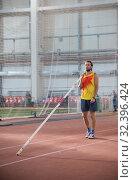 Купить «Pole vaulting - man with a beard is standing with a pole», фото № 32396424, снято 1 ноября 2019 г. (c) Константин Шишкин / Фотобанк Лори