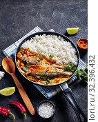 Купить «fish yellow curry with long grain rice», фото № 32396432, снято 11 сентября 2019 г. (c) Oksana Zh / Фотобанк Лори