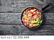 Купить «chilaquiles with ham, cheese, avocado, top view», фото № 32396444, снято 13 сентября 2019 г. (c) Oksana Zh / Фотобанк Лори