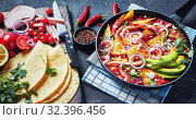 Купить «close-up of chilaquiles in a frying pan», фото № 32396456, снято 13 сентября 2019 г. (c) Oksana Zh / Фотобанк Лори