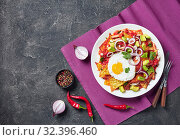 Купить «chilaquiles with a fried sunny side up egg», фото № 32396460, снято 13 сентября 2019 г. (c) Oksana Zh / Фотобанк Лори