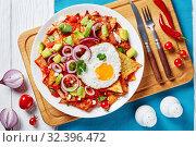 Купить «chilaquiles with a fried egg, top view», фото № 32396472, снято 13 сентября 2019 г. (c) Oksana Zh / Фотобанк Лори