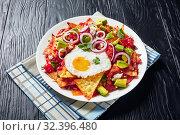 Купить «Fried tortilla chips cooked with eggs, ham», фото № 32396480, снято 13 сентября 2019 г. (c) Oksana Zh / Фотобанк Лори