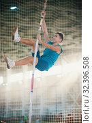Купить «Pole vaulting - man is holding the pole by his hands», фото № 32396508, снято 1 ноября 2019 г. (c) Константин Шишкин / Фотобанк Лори