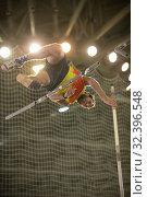 Купить «Pole vaulting - man is jumping over the bar and is going to let go of the pole», фото № 32396548, снято 1 ноября 2019 г. (c) Константин Шишкин / Фотобанк Лори