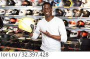 Купить «Portrait of young Afro man satisfied with new riding gear at motorcycle shop», фото № 32397428, снято 16 января 2019 г. (c) Яков Филимонов / Фотобанк Лори