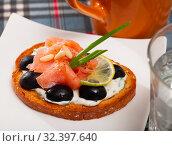 Купить «Delicious canape with salmon fillet», фото № 32397640, снято 5 декабря 2019 г. (c) Яков Филимонов / Фотобанк Лори