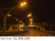 Купить «Western High Speed Diameter (WHSD) at night. Empty illuminated multi-lane highway, St. Petersburg», фото № 32398296, снято 2 ноября 2019 г. (c) Юлия Бабкина / Фотобанк Лори