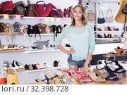 Купить «female in shoes showroom», фото № 32398728, снято 17 августа 2017 г. (c) Яков Филимонов / Фотобанк Лори