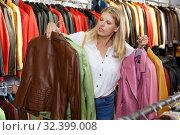 Купить «Woman choosing leather jacket», фото № 32399008, снято 5 сентября 2018 г. (c) Яков Филимонов / Фотобанк Лори