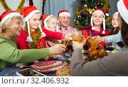 Купить «Family is talking toasts and drinking in time celebration New Year», фото № 32406932, снято 28 декабря 2017 г. (c) Яков Филимонов / Фотобанк Лори