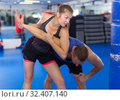 Купить «Happy female is fighting with trainer», фото № 32407140, снято 21 августа 2017 г. (c) Яков Филимонов / Фотобанк Лори