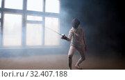 Купить «A young woman fencer showing basic attack movements on the fencing», видеоролик № 32407188, снято 10 апреля 2020 г. (c) Константин Шишкин / Фотобанк Лори