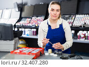 Купить «Female worker picking up color of car upholstery», фото № 32407280, снято 4 апреля 2018 г. (c) Яков Филимонов / Фотобанк Лори