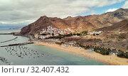 Aerial photography drone point of view of Playa de Las Teresitas beach picturesque distant view of mountainous terrain bright colors Atlantic Ocean, Santa Cruz de Tenerife, Canary Islands, Spain (2019 год). Стоковое фото, фотограф Alexander Tihonovs / Фотобанк Лори