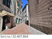 Купить «Kotor, Montenegro - June 10. 2019. Historic Street - Old Town», фото № 32407864, снято 10 июня 2019 г. (c) Володина Ольга / Фотобанк Лори