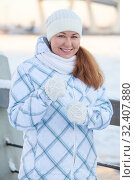 Купить «Young happy woman enjoying winter wearing woolen scarf, mittens and cap. Smiling girl looking at camera.», фото № 32407880, снято 19 января 2014 г. (c) Кекяляйнен Андрей / Фотобанк Лори