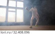 Купить «A young woman fencer in white protective costume performing basic attack movements», видеоролик № 32408096, снято 10 апреля 2020 г. (c) Константин Шишкин / Фотобанк Лори