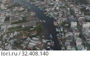 Купить «City life, Cars and Boats traffic in Vietnam 4K Drone shot», видеоролик № 32408140, снято 4 ноября 2019 г. (c) Aleksejs Bergmanis / Фотобанк Лори