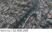 Купить «City life, Cars and bikes traffic on asphalt road in Vietnam 4K Drone shot», видеоролик № 32408208, снято 4 ноября 2019 г. (c) Aleksejs Bergmanis / Фотобанк Лори