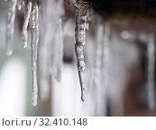 Купить «Beautiful icicles on the roof of the house», фото № 32410148, снято 14 ноября 2019 г. (c) Ирина Козорог / Фотобанк Лори