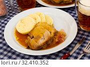 Купить «Pork served with cabbage and knodels», фото № 32410352, снято 16 ноября 2019 г. (c) Яков Филимонов / Фотобанк Лори