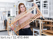 Woman choosing shoe rack in store. Стоковое фото, фотограф Яков Филимонов / Фотобанк Лори