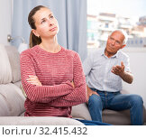 Elderly father and adult daughter quarrelling in domestic interior. Стоковое фото, фотограф Яков Филимонов / Фотобанк Лори
