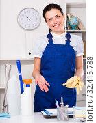 Купить «Young and smiling woman cleaning room», фото № 32415788, снято 2 июня 2017 г. (c) Яков Филимонов / Фотобанк Лори