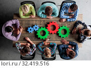 Business people with colorful cogs of business, problem sloution concept. Стоковое фото, фотограф Zoonar.com/Tatiana Badaeva / easy Fotostock / Фотобанк Лори