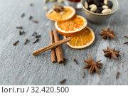 Купить «cinnamon sticks, dry orange slices and star anise», фото № 32420500, снято 4 октября 2018 г. (c) Syda Productions / Фотобанк Лори