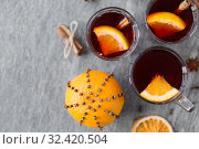 Купить «hot mulled wine, orange slices, raisins and spices», фото № 32420504, снято 4 октября 2018 г. (c) Syda Productions / Фотобанк Лори