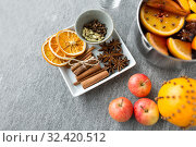 Купить «pot of hot mulled wine, orange, apples and spices», фото № 32420512, снято 4 октября 2018 г. (c) Syda Productions / Фотобанк Лори