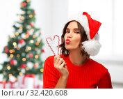 Купить «happy young woman in santa hat on christmas», фото № 32420608, снято 30 сентября 2019 г. (c) Syda Productions / Фотобанк Лори