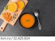Купить «vegetable pumpkin cream soup in bowl with spoon», фото № 32420824, снято 5 апреля 2018 г. (c) Syda Productions / Фотобанк Лори