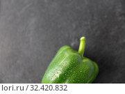 Купить «close up of green pepper on slate stone background», фото № 32420832, снято 12 апреля 2018 г. (c) Syda Productions / Фотобанк Лори