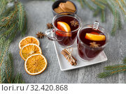 Купить «mulled wine, orange slices, gingerbread and spices», фото № 32420868, снято 4 октября 2018 г. (c) Syda Productions / Фотобанк Лори