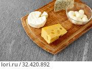 Купить «different kinds of cheese on wooden cutting board», фото № 32420892, снято 16 августа 2018 г. (c) Syda Productions / Фотобанк Лори