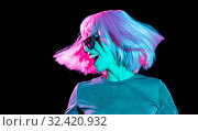 Купить «happy woman in pink wig and sunglasses dancing», фото № 32420932, снято 30 сентября 2019 г. (c) Syda Productions / Фотобанк Лори
