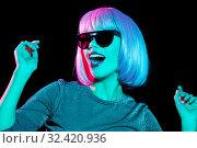 Купить «happy woman in pink wig and sunglasses dancing», фото № 32420936, снято 30 сентября 2019 г. (c) Syda Productions / Фотобанк Лори