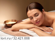 Купить «young woman lying at spa or massage parlor», фото № 32421008, снято 13 октября 2019 г. (c) Syda Productions / Фотобанк Лори