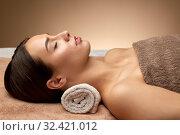 Купить «young woman lying at spa or massage parlor», фото № 32421012, снято 13 октября 2019 г. (c) Syda Productions / Фотобанк Лори