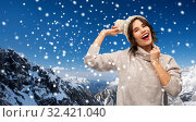 Купить «young woman in knitted winter hat in mountains», фото № 32421040, снято 30 сентября 2019 г. (c) Syda Productions / Фотобанк Лори
