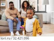 Купить «african baby girl playing with toy blocks at home», фото № 32421096, снято 29 сентября 2019 г. (c) Syda Productions / Фотобанк Лори