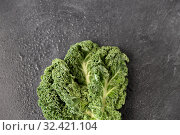 Купить «close up of kale cabbage on slate background», фото № 32421104, снято 12 апреля 2018 г. (c) Syda Productions / Фотобанк Лори