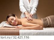 Купить «woman lying and having back massage at spa», фото № 32421116, снято 13 октября 2019 г. (c) Syda Productions / Фотобанк Лори